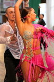 Latino dance couple in action — Stockfoto