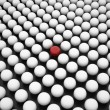 Red Sphere between Array of White Spheres — Stock Photo #12773544