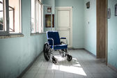 Wheelchair in hospital — Stock Photo