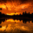 Постер, плакат: Red Dawn Sunrise at Angkor Wat