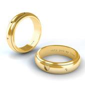 золотые обручальные кольца, изолированные на белом фоне — Стоковое фото