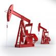 Stock Photo: Two Red Oil pumps. Oil industry equipment.
