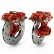 Brake Disc and Red Calliper from a Racing Motorbike isolated on — Stock Photo #38367185