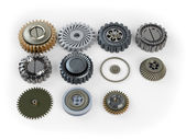 Several machine gears on white background — Stock Photo