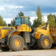 Heavy front loader in open pit — Stock Photo