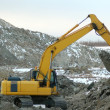 Foto Stock: Digger in open pit