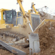 Stock Photo: Bulldozer in open pit