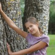 Stock Photo: Girl by birch tree