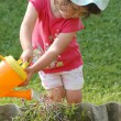 Portrait of baby girl in the garden — Stock Photo