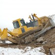 Bulldozer in open pit — Stockfoto #12832900