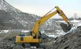 Digger in open pit — Stock Photo