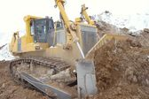 Bulldozer in open pit — Stock Photo
