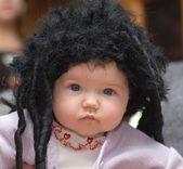 Baby girl in black wig — Stock Photo