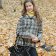 Stock Photo: Portrait of beautiful teenage girl in park