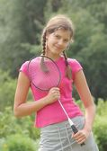 Portrait of beautiful teenage girl with racket — Stock Photo
