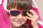 Portrait of baby in sunglasses on the beach — Stock Photo