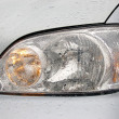 Stock Photo: Headlamp of car
