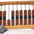 图库照片: Old abacus with modern calculator isolated on white background
