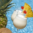 Stock Photo: PinColadCocktail by Swimming Pool