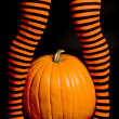 Striped Leggings and a Big Pumpkin — Stock Photo