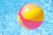 Beach Ball Floating on a Swimming Pool — Stock Photo