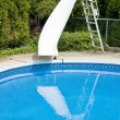 Swimming pool with a slide — Stockfoto
