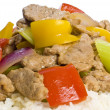 Stir Fried Pork Tenderloin and Vegetables on a Bed of Rice — Stock Photo
