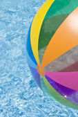Beach Ball Floating in Swimming Pool — Stock Photo