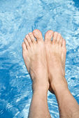 Feet Over the Sparkling Pool — Stock Photo