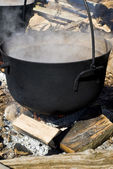 Traditional way of making maple syrup by boiling the sap in a cauldron to concentrate the sugar. — Stock Photo