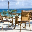 Patio Chairs and Table by a Caribbean Beach — Stock Photo