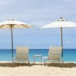 Two White Beach Chairs and Umbrellas — Stock Photo #12339292