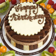 Stock Photo: Triple Chocolate Mousse Birthday Cake with Fruits