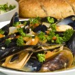 Steamed Mussels Served with Multi-grain Baguette and Salad — Stock Photo