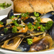 Steamed Mussels Served with Multi-grain Baguette and Salad — Stock Photo #12339980