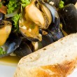 Steamed Mussels Served with a Slice of Baguette — Stock Photo #12339986