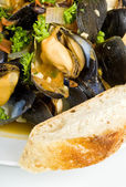 Steamed Mussels Served with a Slice of Baguette — Stock Photo