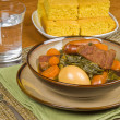 Pork Stew Served with Cornmeal Bread — Stock Photo