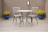 Bistro Table and Chairs on the Deck — Zdjęcie stockowe