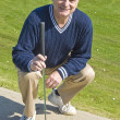 Golfer with a Putter — Stock Photo