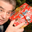 Mature Man with Christmas Gift — Stock Photo #12418718