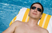 Man Lounging by the Pool — Stock Photo