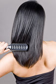 Woman Brushing Her Long Straight Black Hair — Stock Photo