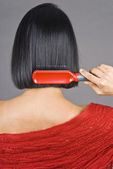 Woman Brushing Her Short Black Hair — Stock Photo