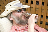 Man Drinking Red Wine on a Lounger — Stock Photo
