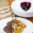 Beef Shank Dinner with Olive Bread and Red Wine — Stock Photo