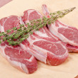 Raw Lamb Chops on Paper — Stock Photo #12675623