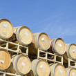 Stock Photo: Stack of Wine Barrels Against Deep Blue Sky