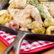 Roasted Cornish Game Hen and Potatoes Garnished with Sprig of Thyme — Stock Photo