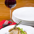 Roasted Cornish Game Hen and Potatoes Garnished with Sprig of Thyme Served with Red Wine — Stock Photo